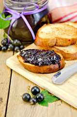 Bread with black currant jam on the board