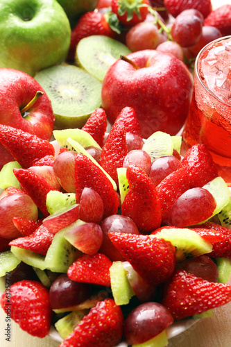 Fruit salad with strawberries, grapes and kiwi