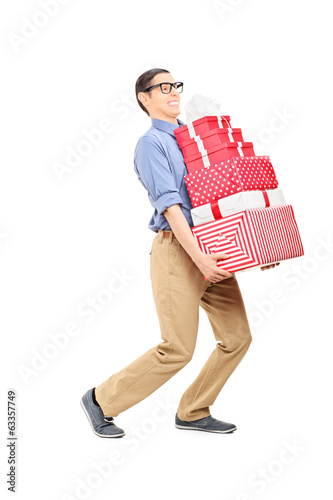 Man carrying a heavy load of presents