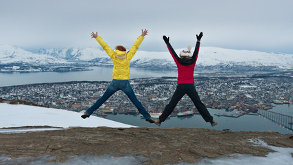 Women jump on the hill in Tromso, Norway.