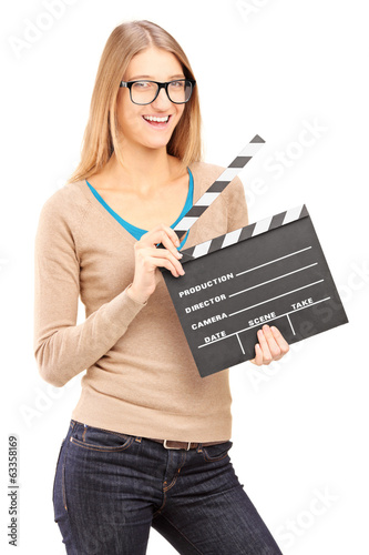 Young woman holding a movie clap