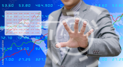 Businessman searching the stock exchange data
