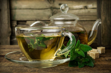 mint tea in glass teapot and cup