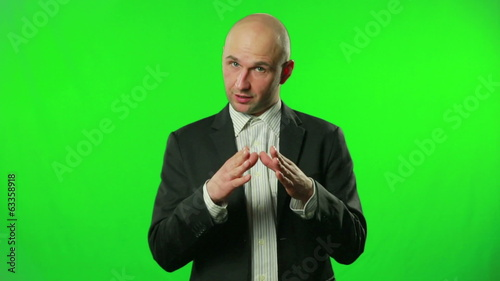 Businessman presenting something in the studio