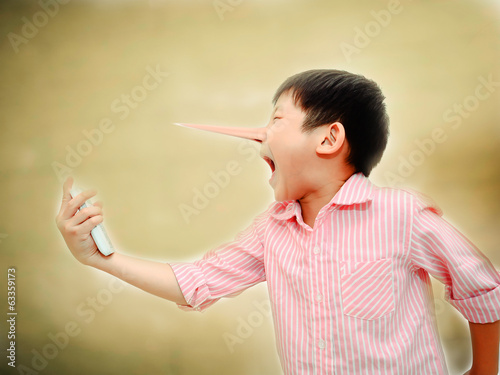 Long nose Angry Asian child shouting At Mobile Phone,liar concep