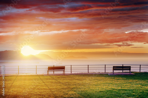 benches in park with at sunset
