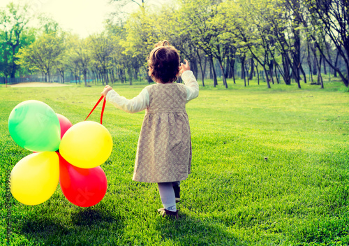 Child with balloons