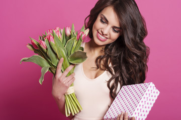 Beautiful woman with flower and cute gift