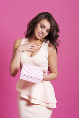 Woman with curly hair holding cute gift box