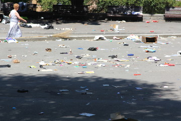 OVIEDO SPAIN, 27 JULY 2013: Poor people collect remains of a str