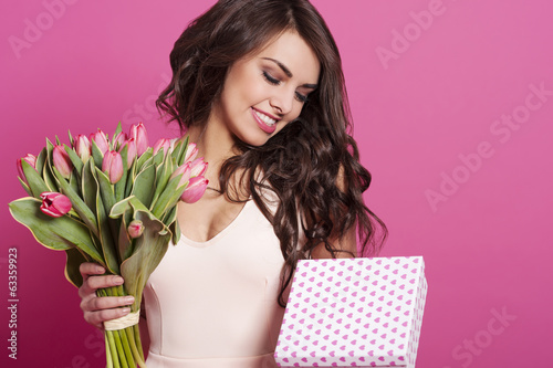 Attractive young woman celebrating holiday