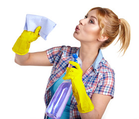 young housewife cleaning on white