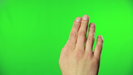 Human hand accessing online data using green screen
