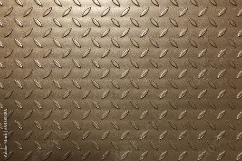 Brown shiny metal background with embossed leaf pattern