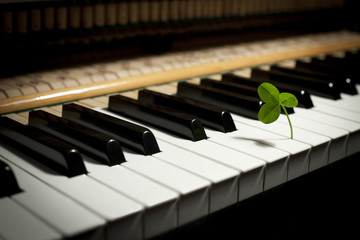 Piano keyboard and clover