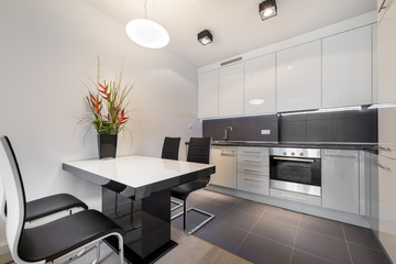 Modern kitchen with gray tile floor