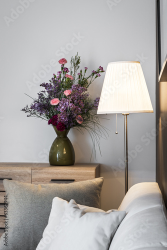 Modern chest with white table lamp