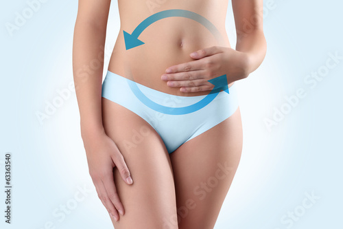 woman hands on belly with blue arrow