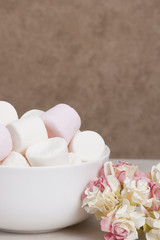 Heap Of Marshmallows In White Bowl. Paper Roses