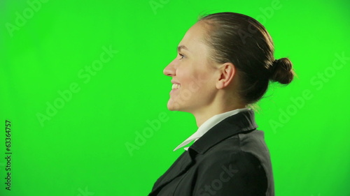 Portrait of a surprised businesswoman against a green screen