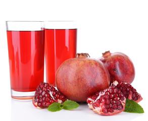 Ripe pomegranates with juice isolated on white