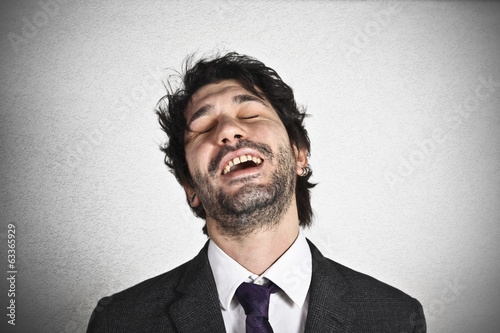 Laughing young businessman