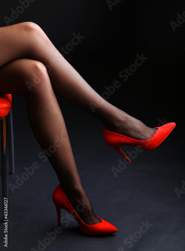Stockings on perfect woman legs on dark background