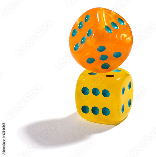 Two colorful dice balanceing on each other