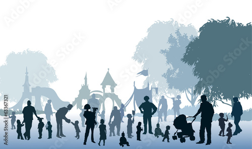 People's silhouettes on playground