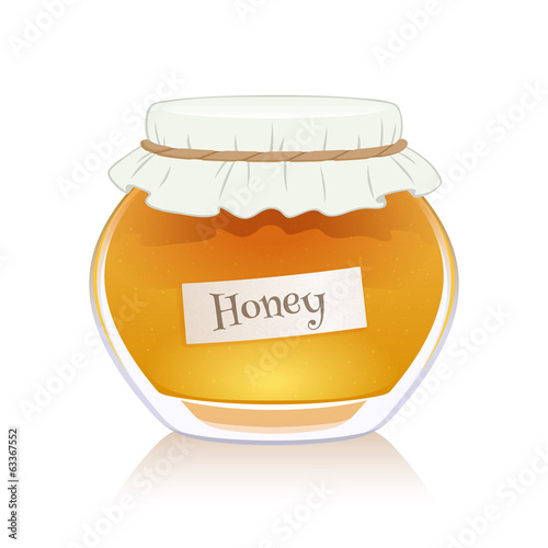 Honey in glass jar isolated on white background.