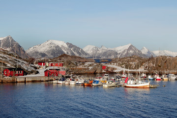 Red cabins of the pleasance harbur of Stamsund