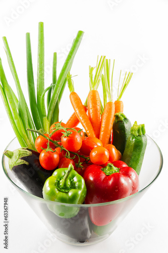 Fresh vegetables in the glass bowl