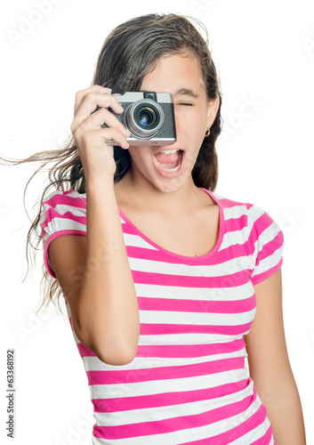 Fun happy young girl taking a photo isolated on white