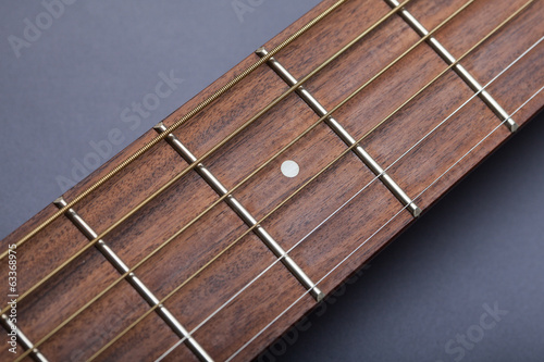 Fretboard on Acoustic Guitar Close-Up on Fifth Fret