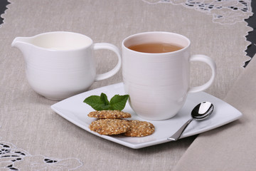 Cookies Made With Sesame, Linseeds And Honey. Tea And Milk