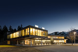 illuminated modern wooden office building at night