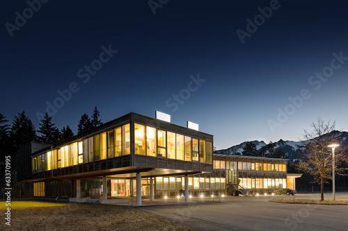 illuminated modern wooden office building at night - 63370995