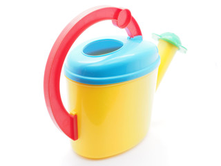 children's watering can on a white background