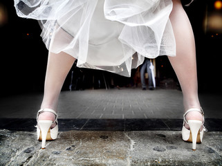 bride with heels legs outdoor background with boyfriend