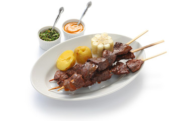 anticuchos, Peruvian cuisine, grilled skewered beef heart meat