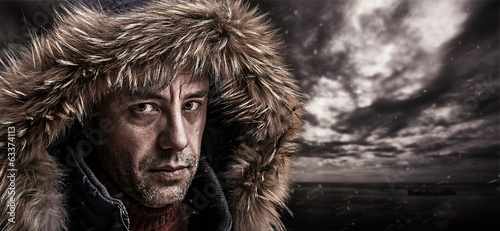 Brutal fisherman dressed in winter clothes.