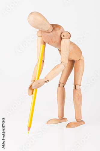 Small wood mannequin stand writing with colour pencil isolated o