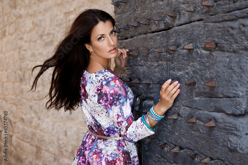woman near the gate with spikes