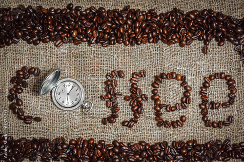 "Coffee textwith retro clock as ""o"""
