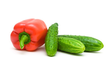 red sweet pepper and cucumbers isolated on white background