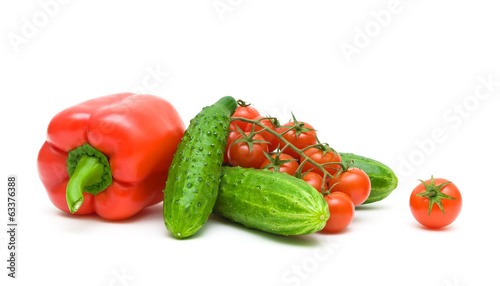 red peppers, cherry tomatoes and cucumbers on a white background