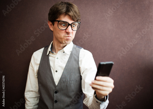 Angry man with mobile smartphone