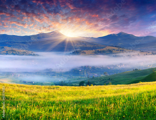 Colorful summer sunrise in the mountains