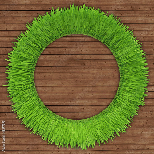 green grass over wood background