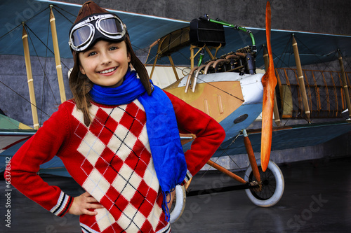 Aviator, happy girl with plane